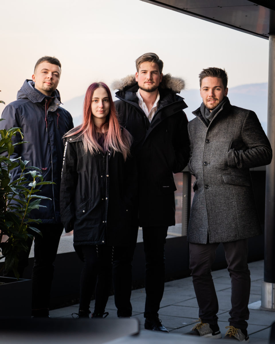 founders, 3 young men and a young woman, in coats