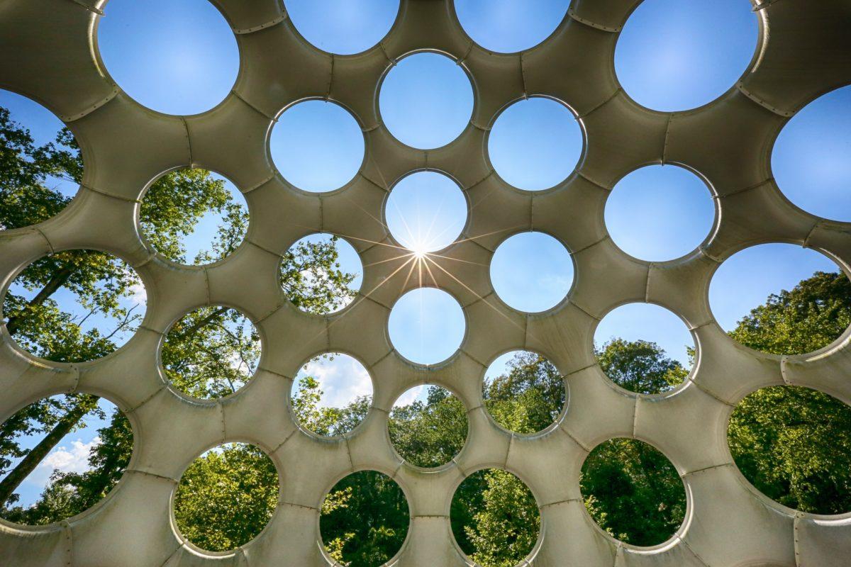 Sunburst shining through the holes in Buckminster Fuller's Geodesic creation at Crystal Bridges.