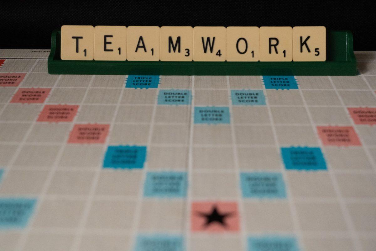 Scrabble: Written word: TEAMWORK