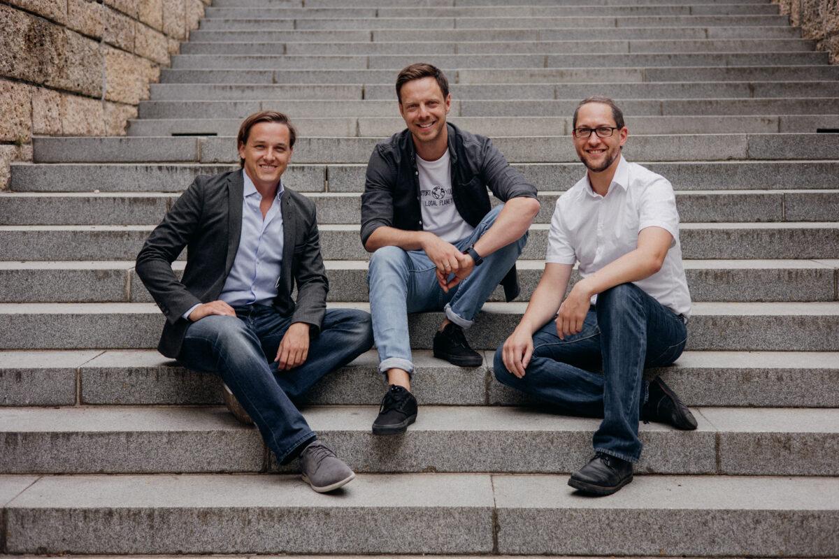 3 men, team ubicube, sitting outside on stairs